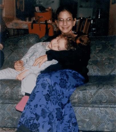 Holding her little sister, Haya Elisheva