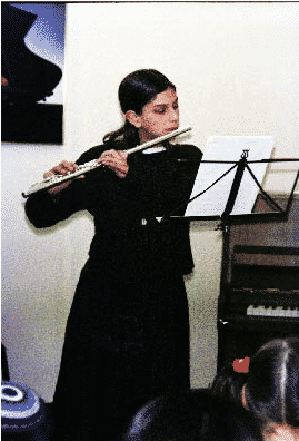 Playing the classical flute at a recital in Jerusalem, April 2001.