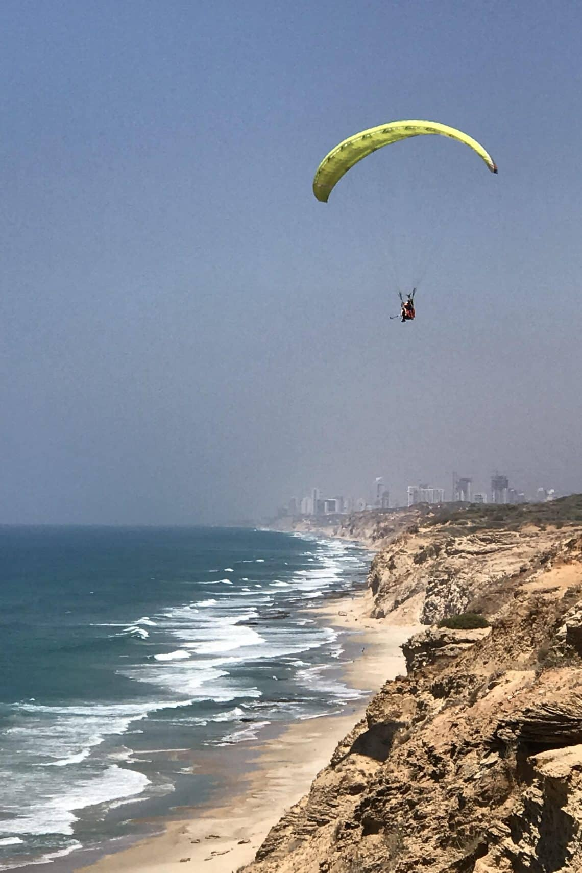 Paragliding over the Mediterranean Sea